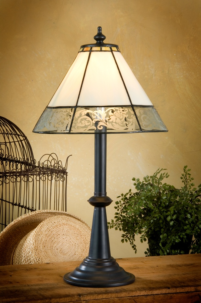 This artistic lamp combines curved ivory stained glass for an overall elegant round shape with the unique etched design on the clear glass surrounding the base. These elements work together to allow this antique-inspired lamp to be as much at home as an unassuming accent or the focal piece of a room. $130.00
