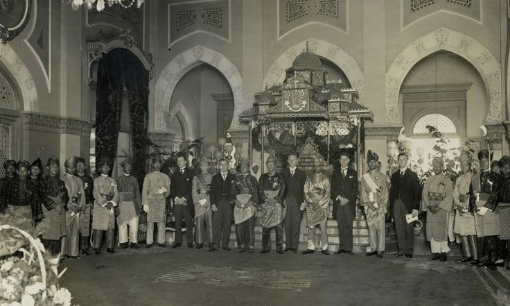 Sultan Alam Shah Amaluddin Sani Perkasa (to 13 from left) with the crown prince and the nobles and officials in the Palace Residency of East Sumatra Maimoon, Medan (circa 1920's)