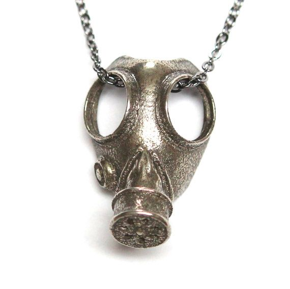 This classic World War 2 era gas mask is scaled down to 1-1/8 long by 3/4 wide. It is cast in solid white bronze with a textured oxidized finish that gives