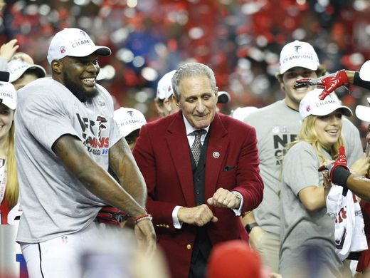 Falcons owner Arthur Blank celebrates with players