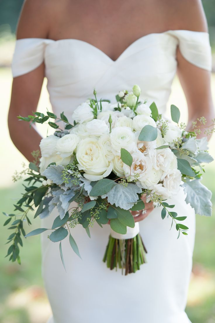 Hand-tied arrangement featuring roses, ranunculus, liasianthus, dusty miller, snowberry, eucalyptus and bay laurel / Iris Photography