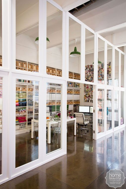 Material girl: sleek glass panelling and 4.5-metre high ceilings infuse the office with the feel of a loft warehouse.