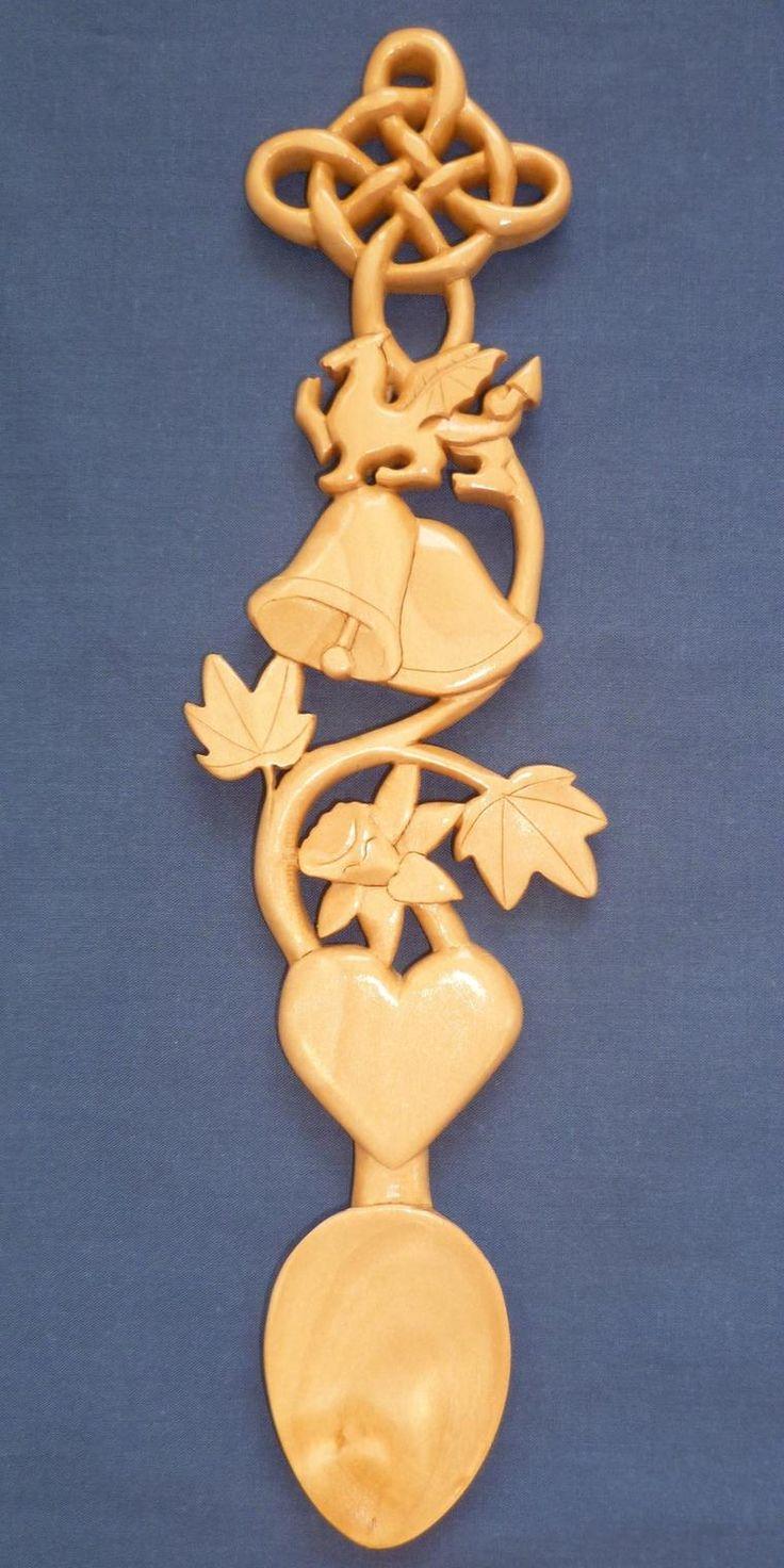 Wedding bells, dragon,daffodil and knot love spoon