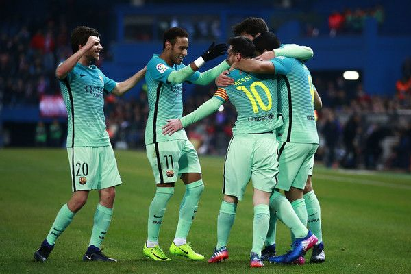 Lionel Messi (2ndR) of FC Barcelona celebrates scoring their second goal with teammates Luis Suarez (R), Neymar JR. (2ndL) and Sergi Roberto (L) during the Copa del Rey semi-final first leg match between Club Atletico de Madrid and FC Barcelona at Estadio Vicente Calderon on February 1, 2017 in Madrid, Spain.