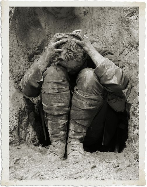 """A shell shocked soldier in the trenches during World War One. """"I don't know why, but I find this image strangely beautiful. Grievous, but beautiful. I am not sure of the photographer of this piece or the name of the soldier in the photo. I do know that it is the cover image of the book """"Broken Men: Shell Shock, Treatment and Recovery in Britain, 1914-30,"""" written by Fiona Reid. If anyone knows the photographer's name, I would appreciate it very much.""""~Sethaka."""