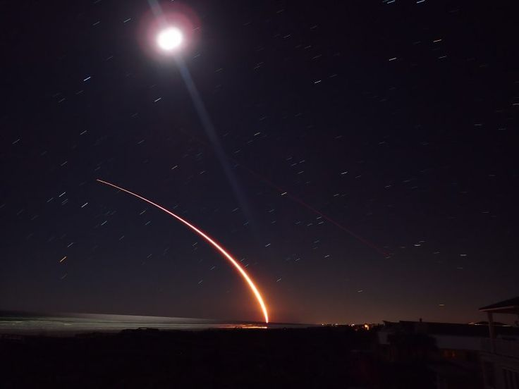 Richard Benzinger in Crescent Beach, Florida caught the March 16, 2017 SpaceX launch of Echostar XXIII from Cape Canaveral, shooting southeast with the moon above.