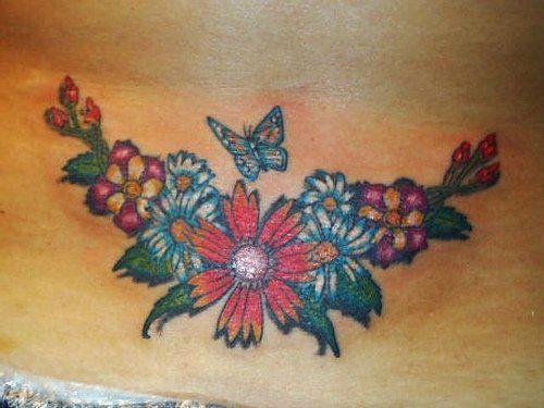 tatuaż kolorowe kwiaty i motyl