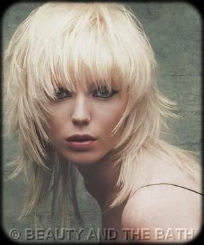 cutting my hair this weekend and thinking of a shag style like this one.