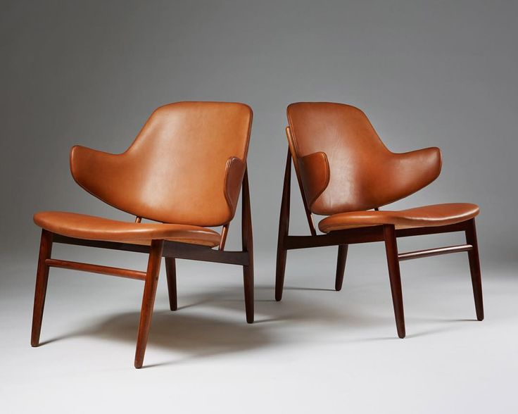 A Pair Of Rosewood And Leather U0027Penguinu0027 Chairs Designed By Ib Kofod Larsen  For