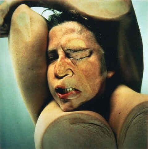 Jenny Saville self portrait on top of a glass table with the photographer under the table taking it upwards to create the abstract effect of the deformed body.
