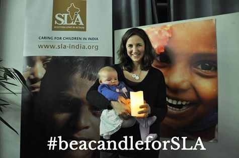 Showing the light of a candle to a small child, giving them the light of love. Help share the campaign #beacandleforSLA. www.sla-india.org/