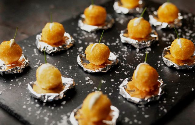 Dauphine potatoes with crème fraîche. Mashed potato is mixed with pate a choux and then fried. Savory recipe.