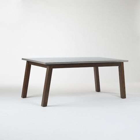 West Elm wooden table with stainless steel top. The lines of the legs pick up on the shape of our sofa and chair, and the table balances their chocolate color without filling the room with dark, heavy furniture.