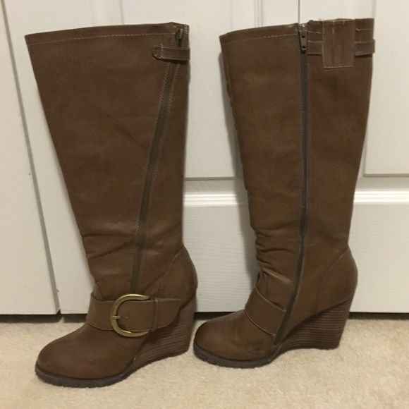 Brown wedge boot Brown wedge boot with full zipper. Back right boot has a small scuff shown in picture. These are super comfortable I've wore them twice, they are too tall for me. Shi Shoes Heeled Boots