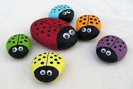 Rocks painted like ladybugs...fun outdoor craft for the summer----reminds me of when I used to decorate the rocks around my grandma's house when I was a kid