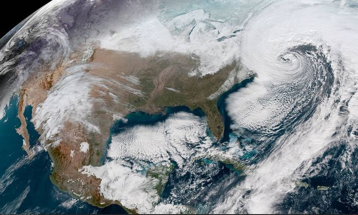 Satellite image of United States with storm clouds off East Coast