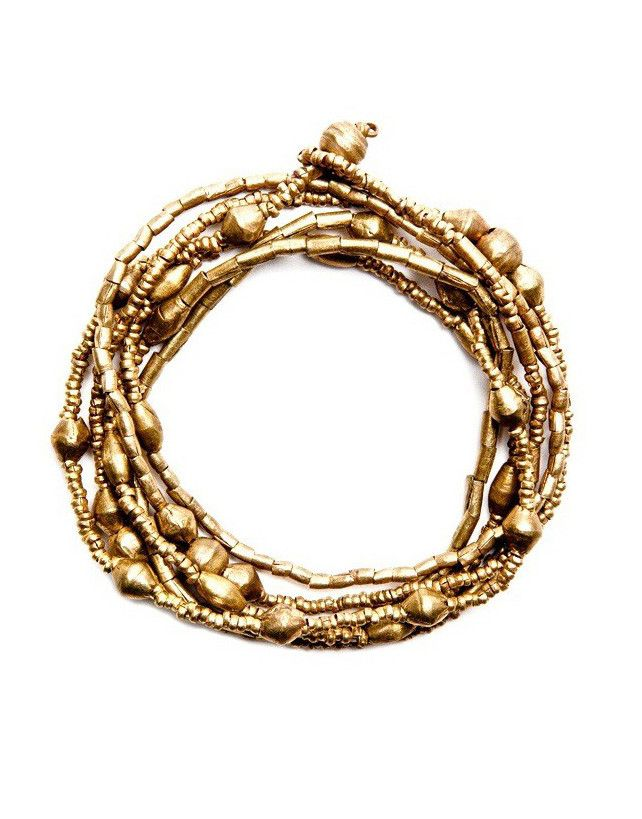 The Keranga gold #wrap #necklace #bracelet is made from found artillery shells in the mountains of Northern Ethiopia. The artillery shells are skilfully made in to beautiful #jewellery by local Ethiopian women. hamlin.org.au