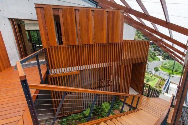 Fabulous Wood Clad Exterior Design at Modern Home with Outdoor Staircase Nearby the Garden Applied Wire Balustrade