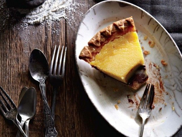 If you're sick of lemon pies topped with cloying clouds of meringue, give this pie a try. A layer of dark chocolate ganache lines the crust, topped with a Meyer lemon curd infused with orange zest. It's a beautiful interplay between dark and light, bitter and sweet flavors.