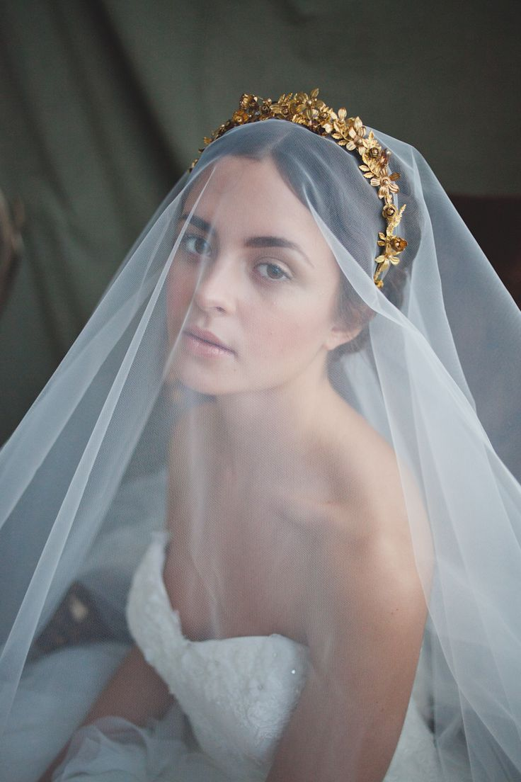 A modern take on the tiara, this beautiful crown-like hairband is made up of gold metal flowers, leaves, Swarovski gold pearls and gold tone crystal rhinestones. Each flower is lovingly hand wired onto a gold plated band making each band slightly different to another and unique to the wearer. The band is stunning alone or equally as effective over a veil. This piece is handmade to order and will ship within 4-6 weeks after payment has been received. Please contact me regarding rush orders…