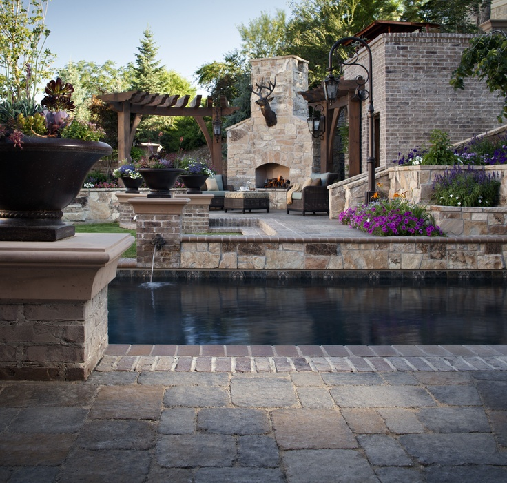 Belgard Outdoor Patio Featuring #MegaBergeracPaver Love The Lion Fountains  Into The Pool Nice Combo Of