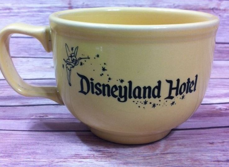"""Disneyland Hotel 'Stromboli's Ristorante' Jumbo Mug made by Homer Laughlin China Company. This Yellow mug with black lettering and Tinkerbell logo is a rare collectible from a former Disney restaurant and measures approximately 3.25"""" tall and 4.25"""" across top opening   eBay"""