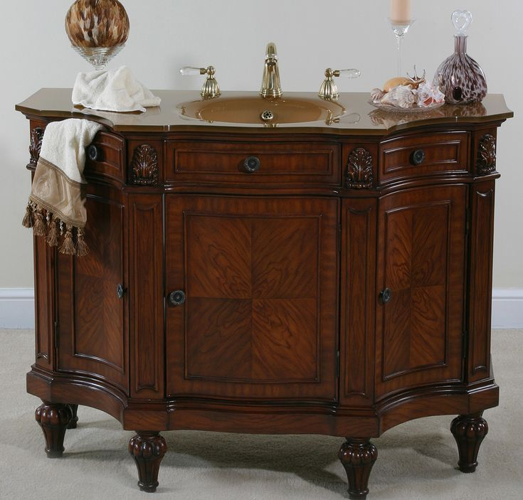 Accents Cherry Burl Discount Bathroom Vanity Empire styled sink chest http://www.listvanities.com/discount-bathroom-vanities.html is convenient and a great way store all your bathroom items. Understated and elegant. Includes a glass top, Two working side drawers, and the three doors have 1 adjustable shelf on the inside.