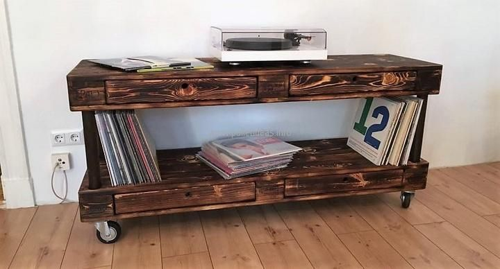 Another idea for creating a TV stand on wheels, it is painted brown and it is not looking weird as if created by an unprofessional. The pallets are smooth and there is no need to get the professionally created TV stand when a person can make it at home.