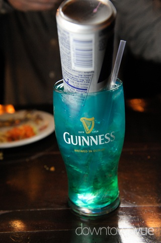 Irish Trash Can: .5 oz. Light Rum, .5 oz. Gin, .5 oz. Vodka, .5 oz Triple Sec, .5 oz. Peach Schnapps, .5 oz. Blue Curacao, (1) 8 oz. can of Red Bull