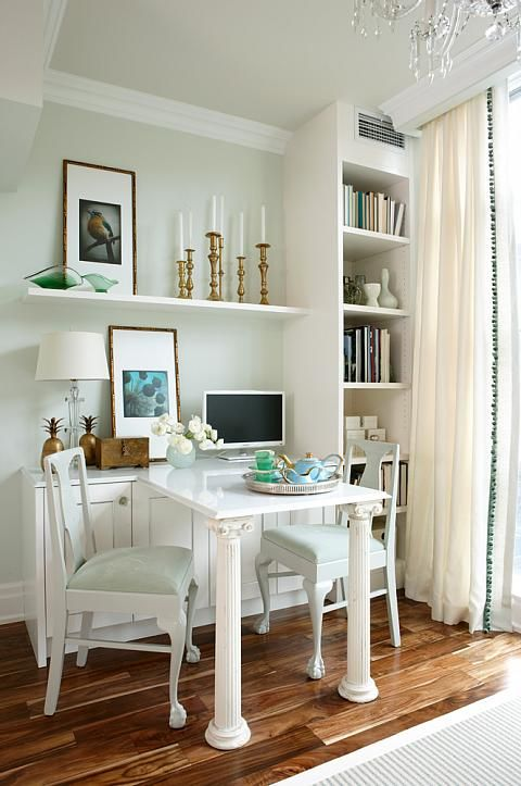 Brass, emerald, and mint are colors featured in this office. I love that there's a table and two chairs for those times you want to have a meeting with someone.