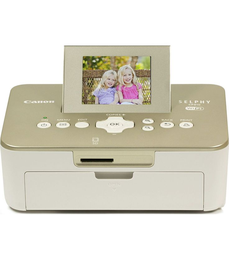 Canon Selphy Photo Printer in Gold Teresa Collins- <b>Exclusive to Joann.</b> <b>Convenient, light and portable, wireless compact photo printer</b> With the Teresa Collins-appr