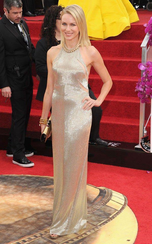 Naomi Watts in Tom Ford dress, Bulgari vintage Serpenti watch-bracelet, Bulgari gold python clutch and Bulgari necklace