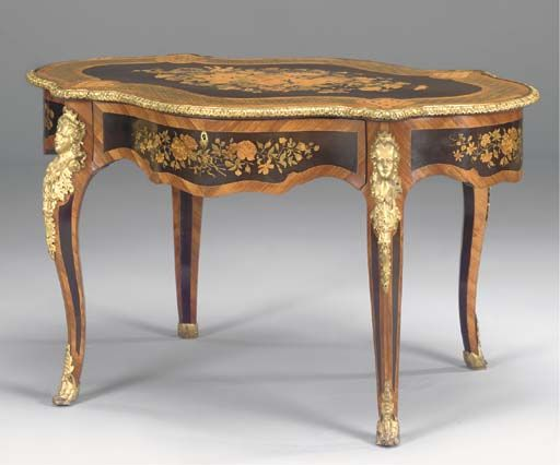 A NAPOLEON III GILT METAL MOUNTED TULIPWOOD STAINED PEARWOOD AND MARQUETRY  SERPENTINE CENTRE TABLE THIRD