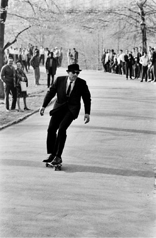 Gregory Peck rides a skateboard, c. 1960s