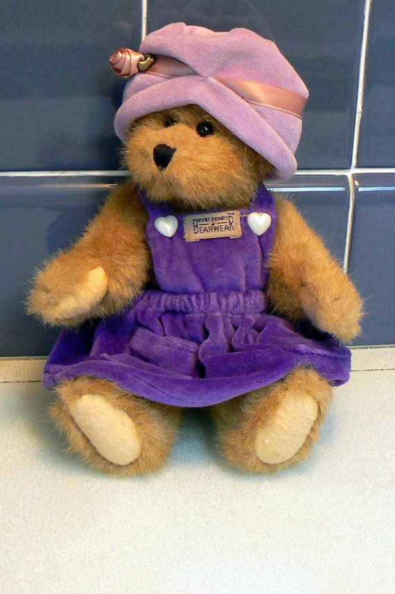 Boyds Bear Bailey is 8 tall and is a plush jointed brown bear. Bailey has the original velvet purple jumper and cloche hat with a pink rose. Bailey