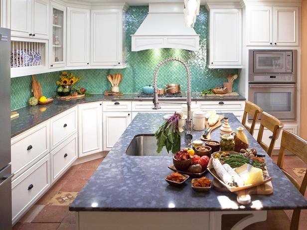 kitchen with a beautiful sea blue green backsplash  FERRARI KITCHEN