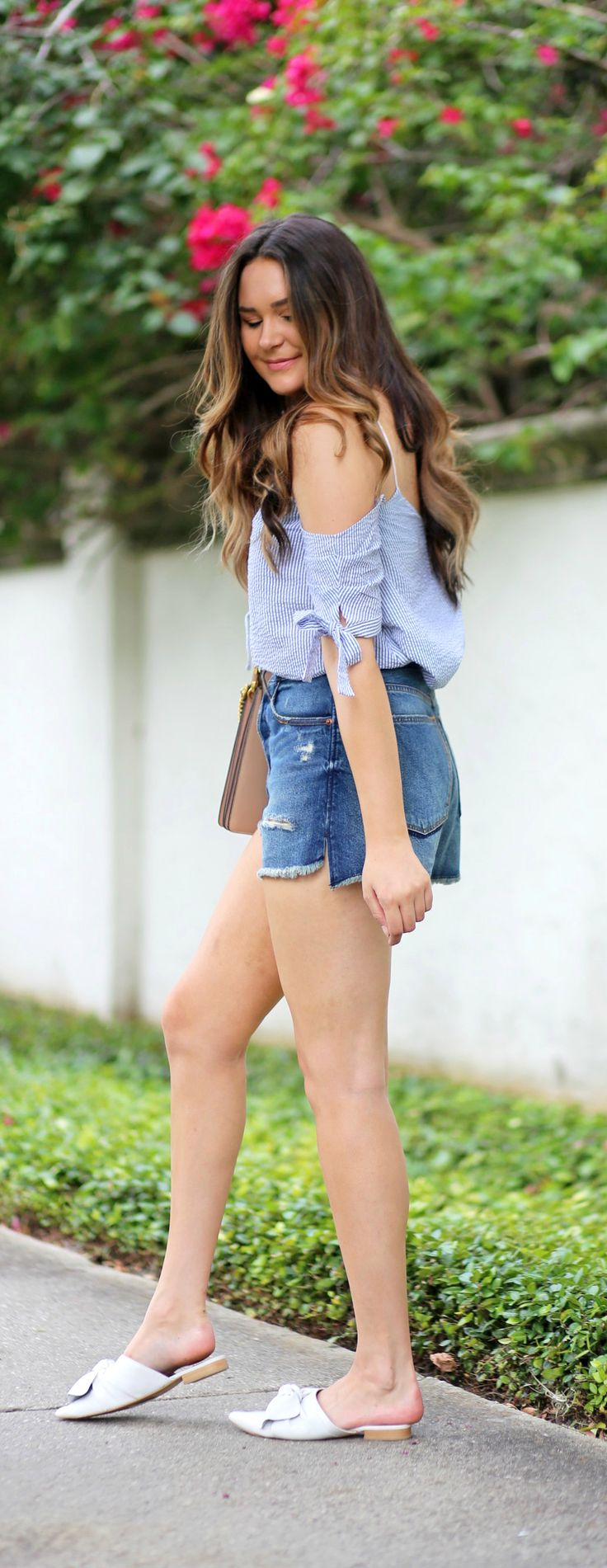 Need this entire outfit! | Fashion blogger Mash Elle styles a blue striped seersucker off the shoulder top from Urban Outfitters  with high waisted cut off ripped jeans short from Abercrombie and Fitch shorts, Michael Hill watch, and Chloe Faye purse.