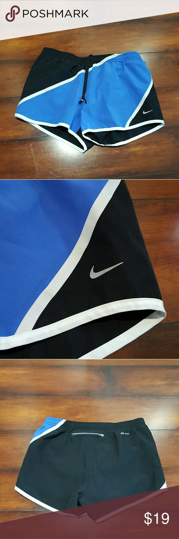 NWOT WOMEN'S NIKE running shorts, size small NWOT Women's black, blue and white Nike running shorts, size small. Nike Shorts
