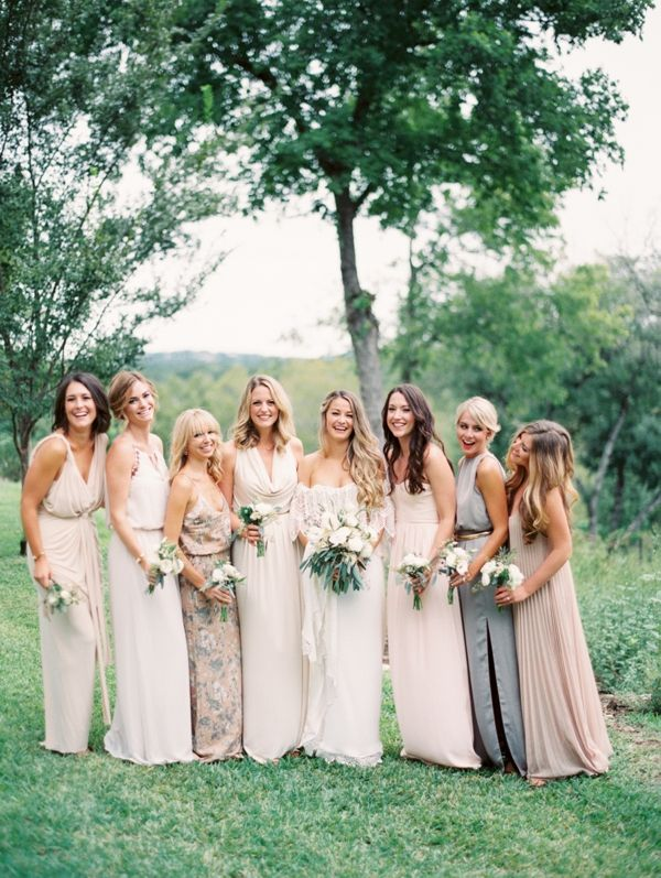 Varied full-length bridesmaid dresses. Photo by Taylor Lord.