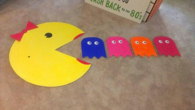 Pac man and ghosts. 80s decorations could make these outa cardboard