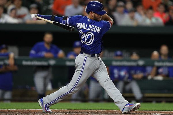 Josh Donaldson Photos Photos - Josh Donaldson #20 of the Toronto Blue Jays strikes out against the Baltimore Orioles during the eighth inning at Oriole Park at Camden Yards on April 5, 2017 in Baltimore, Maryland. - Toronto Blue Jays v Baltimore Orioles