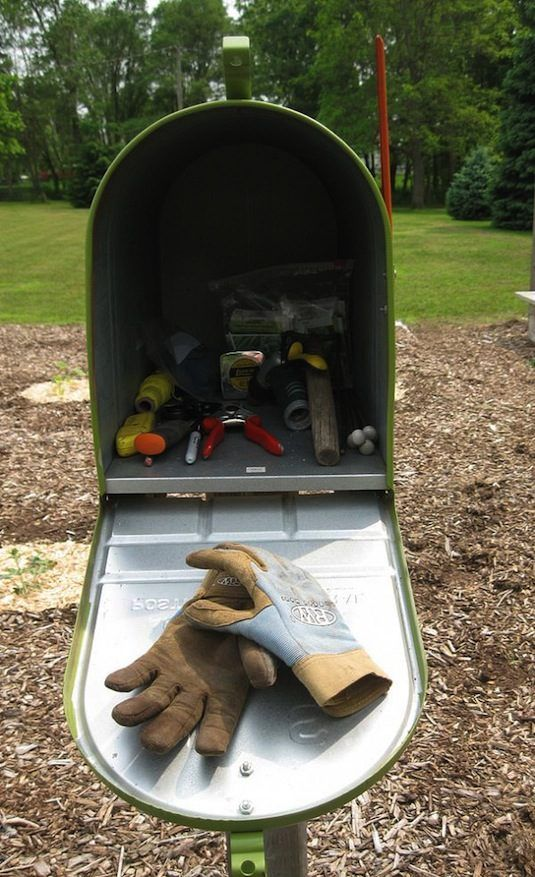 50 Genius Storage Ideas ~ Keep your small garden tools and gloves handy in a charming mailbox!