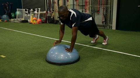 Elite 400m sprinter Greg Nixon performs a four-exercise circuit designed to improve his core strength and stability.