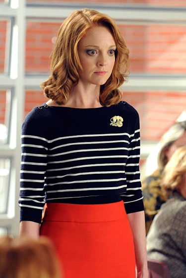Jayma Mays as Emma Pillsbury in Glee. The vintage pin is a touch of genius.