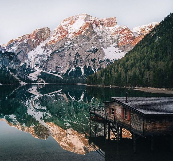 A boathouse in Braies Trentino-Alto Adige Italy looks out upon the Dolomites mountain range. PC: Merlin Kafka  ten trees are planted for every item purchased: http://ift.tt/1gvwPkT  #nature #inspire #explore #outdoors #tentree