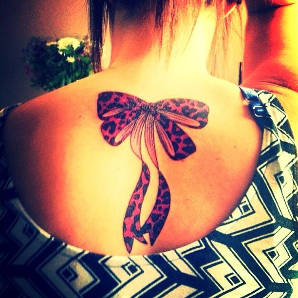 Leopard Bow Tattoo. Not advocating @ All. Just saying...