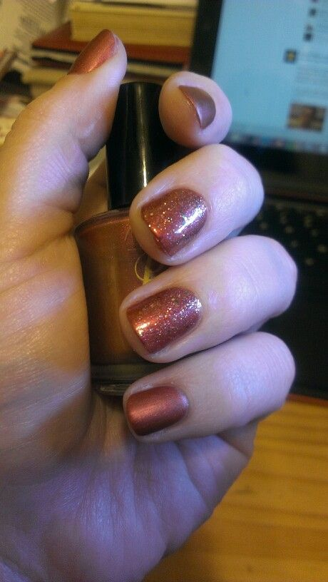 My Miss Piggy-inspired manicure. Base is Nina Ultra Pro in Molten Ruby, glitter is Designer De Better from OPI for the Muppets collection, plain nails were topped with NYC Matte Me Crazy top coat.