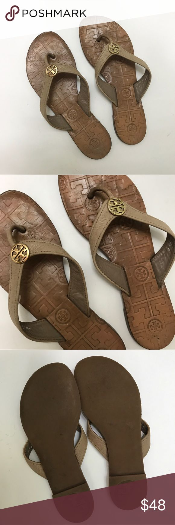 "Tory Burch Thora Leather Taupe Flip Flops Sandals Tory Burch Thora Leather Taupe Cream  Flip Flops Sandals. Gold Medallion. Size mark sticker on inside strap worn off. Measures as 5.5 but please measure against you own flip flop. Measures tip to tip 9-1/8"" length and 3-3/8"" width, 7.5"" to strap from the back. Worn condition. Leather and medallion are in very good condition. Sole and footbed have wear. Please let me know if you have any questions. Tory Burch Shoes Sandals"