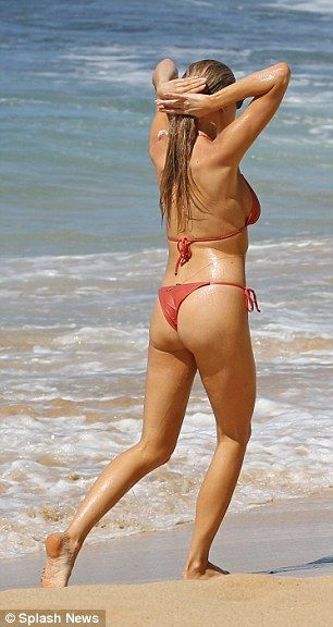 Bathing beauty: The 23-year-old model-turned-actress took a dip in the ocean while clad in a coral string bikini