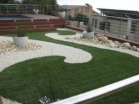 well designed area to make the artificial turf really stand out